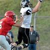(Brad Davis/The Register-Herald) Westside's Jacob Ellis makes a catch against Liberty Friday night in Glen Daniel.