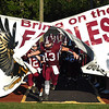 Noah Norman, of Woodrow Wilson, breaks through the Fling Eagles banner for game against Riverside High School at Van Meter Stadium in Beckley Friday night.<br /> (Rick Barbero/The Register-Herald)