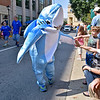 (Brad Davis/The Register-Herald) A youngster in a shark suit walking with the Perry Memorial Methodist Church group gives high-favis to all who want one during the Kid's Classic Parade Saturday morning along Main Street.