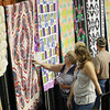 Friday during the opening day of the annual Appalachian Arts and Craft Fair at the Beckley Raleigh County Convention Center. (Chris Jackson/The Register-Herald)