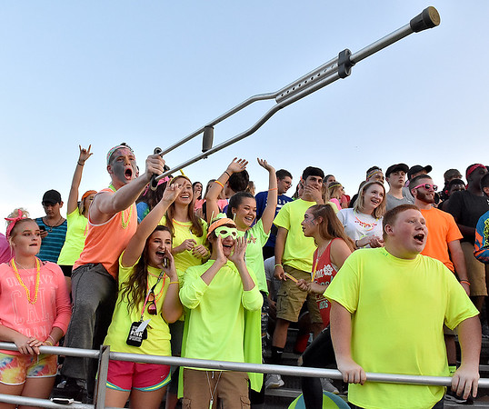 (Brad Davis/The Register-Herald) A rowdy Liberty student section borrows a page out of the Clear Fork Crazies playbook and dress up in bright neon colors for the Raiders' season opener against Westside in Glen Daniel.