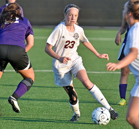(Brad Davis/The Register-Herald) Woodrow Wilson freshman Hattie Hall cuts through Riverside defenders during the Flying Eagles' win over the Lady Warriors Thursday evening at the YMCA Paul Cline Memorial Sports Complex.