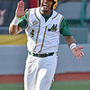 (Brad Davis/The Register-Herald) West Virginia's Tre Porter claps his hands in celebration as he rounds third for home following Keanan Locke's three-run double during the 5th inning of the Miners' extra innings win over Champion City Sunday evening.