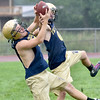 (Brad Davis/The Register-Herald) Shady Spring players Garrett Jones, left, and Hunter Monette battle for the ball while running receiving drills during Tigers football practice Wednesday afternoon.