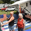 Christine Boyce, of Nettie, left, with her mom Verlis Amick, of Leivasy, fixes her flag on her camper at the State Fair grounds in Fairlea. They have been camping during the fair for 40 years.<br /> (Rick Barbero/The Register-Herald)