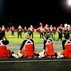 Oak Hill's cheerleaders watch as their marching band perform at halftime of their game against Liberty in Oak Hill on Friday. (Chris Jackson/The Register-Herald)