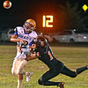 (Brad Davis/The Register-Herald) Shady Spring quarterback Joe Cantley just gets the ball away in time as he's hit in the backfield by Summers County's Christian Pack Friday night in Hinton.