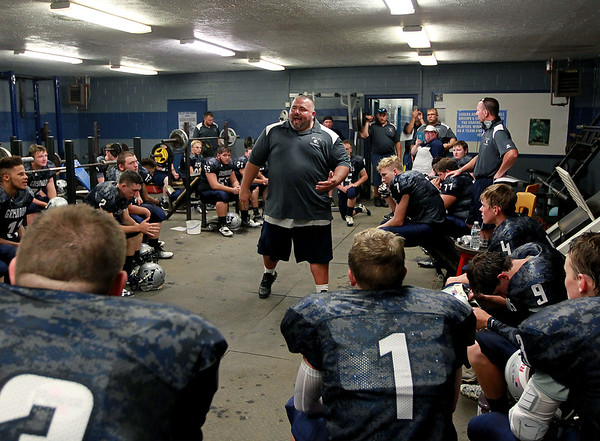 """Valley High Football's head coach Makie McCommack talks to his team prior to their season opener against Clay-Battelle at their new football field in Smithers on Friday. McCommack told his team that they finally have a home now, and that """"we've got to protect it."""" (Chris Jackson/The Register-Herald)"""