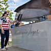 (Brad Davis/The Register-Herald) Local leaders, paramedics, Beckley Police officers and area residents form a line and take turns putting a hand on the September 11th Memorialas they walk by during a special ceremony at Word Park Sunday afternoon.