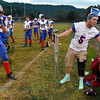 (Brad Davis/The Register-Herald) Injured Midland Trail running back and linebacker Todd Neal, right, hangs out and supports his teammates in any way he can, including grabbing a few bottles of water Friday night at Meadow Bridge.