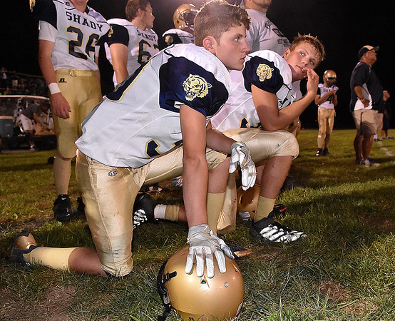 (Brad Davis/The Register-Herald) Shady Spring's Brandon Bennett, near, and Keith Sexton watch from a knee as events unfold during the Tigers' road game at Summers County Friday night in Hinton.