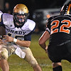(Brad Davis/The Register-Herald) Shady Spring's Tyler Bragg carries the ball Friday night in Hinton.