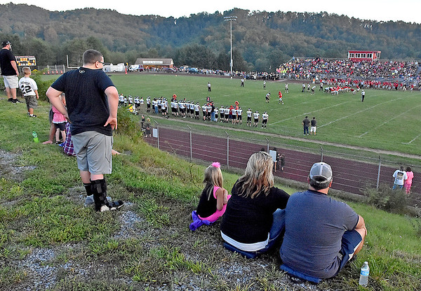 (Brad Davis/The Register-Herald) Westside fans and family take advantage of a hillside above the visiting team bleachers during the Renegades' game at Liberty.