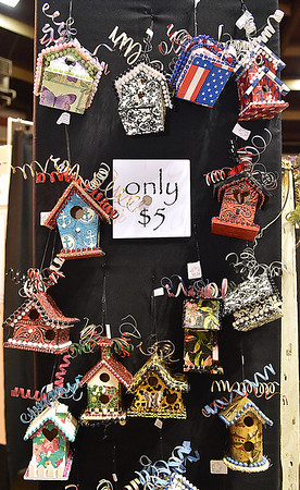(Brad Davis/The Register-Herald) An array of tiny metal birdhouses hang on display at the booth of Lewisburg metal and wood artist Mimi Karnes Saturday afternoon at the Appalachian Arts and Crafts Fair.