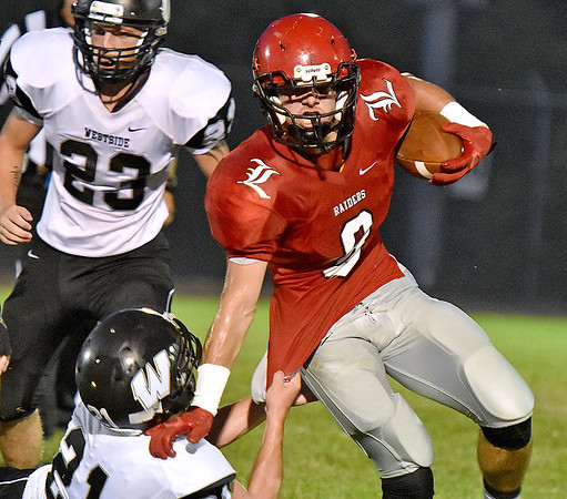 (Brad Davis/The Register-Herald) Liberty's Jacob Bailey carries the ball Friday night in Glen Daniel.