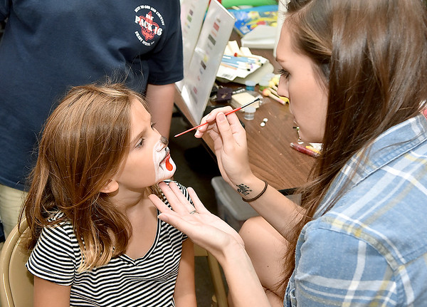 (Brad Davis/The Register-Herald) Seven-year-old Alex Gwinn gets her face painted during the Kids Classic Festival Saturday.