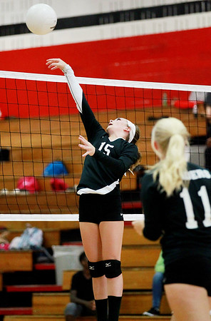 Liberty's Makiya Caron (15) strikes the ball over the net during their match against Meadow Bridge in Oak Hill on Tuesday. (Chris Jackson/The Register-Herald)