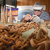Lance Brooks, of Fairdale, owner of Midnight Carver, making a wooden chain at the West Virginia State Fair in Fairlea.<br /> (Rick Barbero/The Register-Herald)