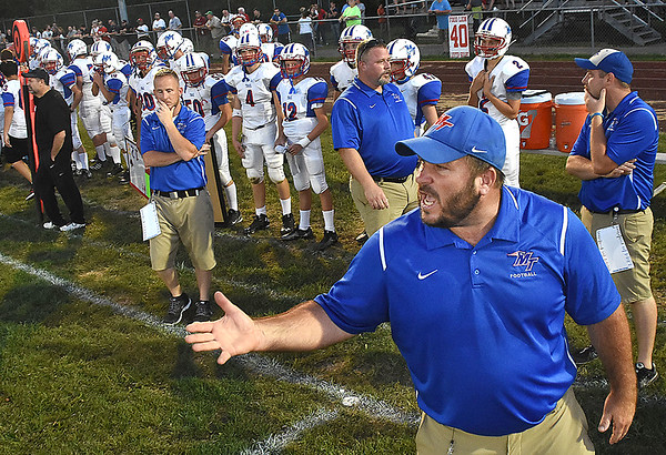 Midland Trail head coachFrank Isaacs, yells out instructions to his team during the second quarter againt Independence at Independence High School in Coal City Friday night.<br /> (Rick Barbero/The Register-Herald)