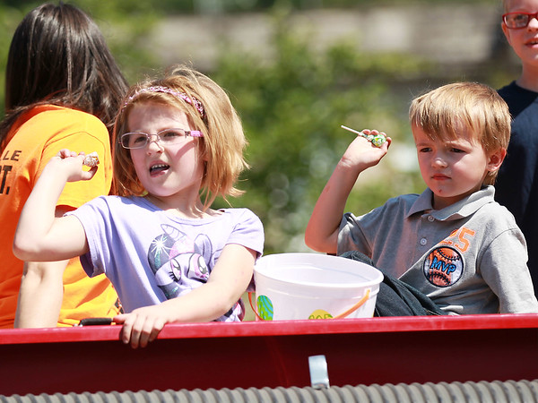 Children throw candy from a fire truck during the annual Pineville Labor Day Parade on Monday. (Chris Jackson/The Register-Herald)