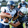 Valley's (21) tackles Clay-Battelle's (30) during the first quarter of their football game in Smithers on Friday. (Chris Jackson/The Register-Herald)