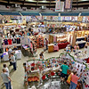 Fair goers and vendors during the opening day of the annual Appalachian Arts and Craft Fair at the Beckley Raleigh County Convention Center on Friday. (Chris Jackson/The Register-Herald)