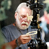 """Danny Thomas, from Bidwell, Ohio, works to make porcelain wind chimes at the """"Wind Chimes by Debra"""" booth Friday during the opening day of the annual Appalachian Arts and Craft Fair at the Beckley Raleigh County Convention Center. (Chris Jackson/The Register-Herald)"""