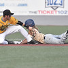 (Brad Davis/The Register-Herald) Quicy's Houston Looser steals second base during game one of the Prospect League championship series against the West Virginia Miners Thursday night at Linda K. Epling Stadium in Beckley.