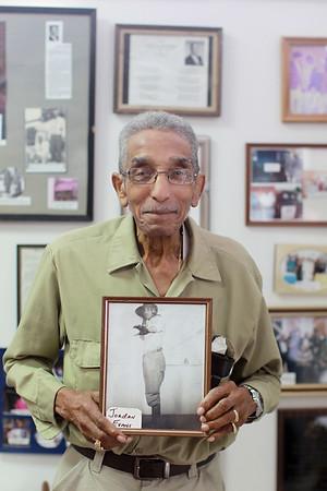 DuBois High School graduate Jordan Evans 1946 holds a photo of himself when he played football for the team. (Chris Jackson/The Register-Herald)