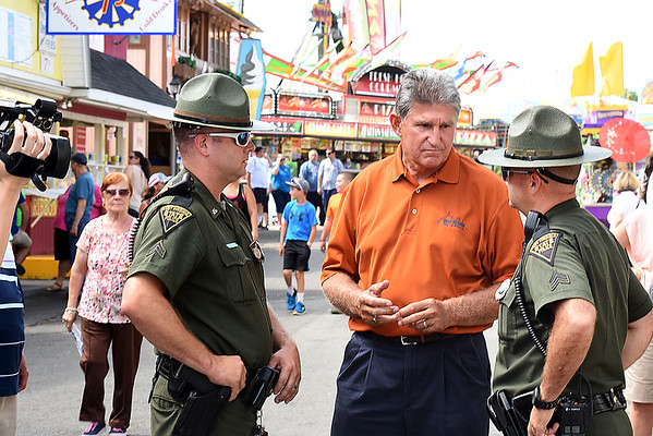 Senator Joe Manchin, center, talks with state trooper, Mark Agee, left, and Sgt. D.A.Evans at the West Virginia State Fair in Fairlea.<br /> (Rick Barbero/The Register-Herald)