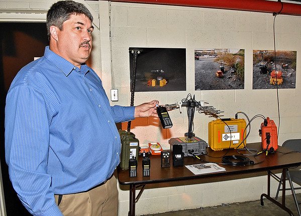 (Brad Davis/The Register-Herald) Mike Jude, training instructor at the National Mine Health and Safety Academy, shows some of the advanced communication equipment used at mine sites during a tour of the facility Wednesday afternoon.
