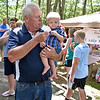 (Brad Davis/The Register-Herald) Kernersville, North Carolina resident Eddie Lilly is a bit too occupied to chat with the Register-Herald as he assists his nine-month-old grandson Gunner Lilly, who was making his first ever gathering, with some ice cream during the 87th annual Lilly Family Reunion Saturday afternoon on the family's grounds in Mercer County.