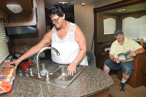 Reda Justice, of Panther, is preparing lunch for her husband Ycineth Jusctice, in ther camper at the West Virginia State Fair in Fairlea.<br /> (Rick Barbero/The Register-Herald)