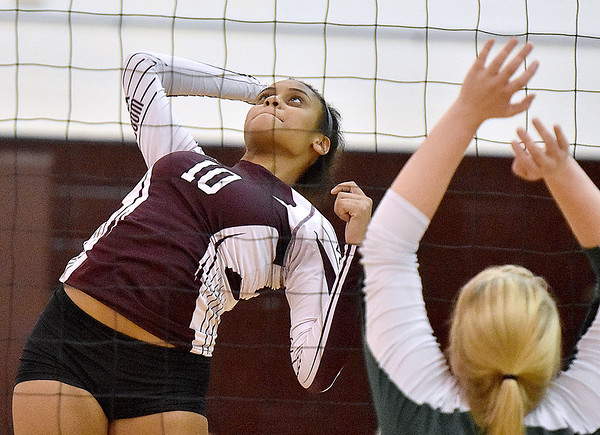 (Brad Davis/The Register-Herald) Woodrow Wilson's DeJaha Morris goes up to spike the ball during a matchup against Huntington during the Shirley Brown Invitational Saturday morning at Woodrow Wilson High School.