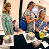 (Brad Davis/The Register-Herald) From left, Beckley residents Carolyn Cook, Amy Bennett and her daughter Grace sample some homemade chip dips you can make from the RiCa's Best Dip Mixes' booth during the final day of the Appalachian Arts & Crafts Fair Sunday at the Beckley-Raleigh County Convention Center.