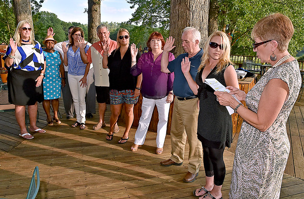 (Brad Davis/The Register-Herald) Paula Miller of the West Virginia Association of Realtors, right, officiates the installation ceremony for new Beckley Board of Realtors officers Thursday evening at Daniel Vineyards in Crab Orchard. Officers installed were Kay Booth (President), Paige Powers (1st VP), Mike Tyree (2nd VP), Diane Meador-Cole (Secretary), Jerry Zaferatos (Treasurer), Marla Sinko (Director '19), Pam Lynch (Director '18), Beth Keatley (Director '18) and Tim Berry (Director '17).
