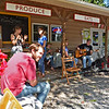 (Brad Davis/The Register-Herald) Local farmers and musicians spend time relaxing and playing music outside the farm stand at the Lansing General Store September 9.