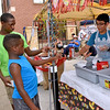 (Brad Davis/The Register-Herald) At left, 14-year-old Jacoby Harvill and 10-year-old Elijah Page get a couple of walking tacos from the Kiwanis booth during taste of Beckley Saturday.
