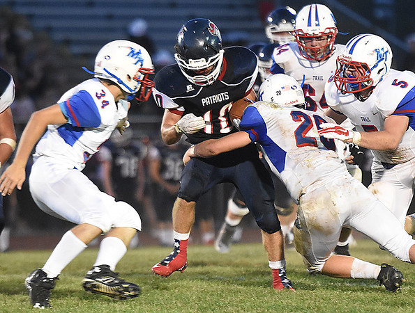 Connor Gibson, 10, of Independence, tries to break away from  Midland Trail defenders during game at Independence High School in Coal City Friday night.<br /> (Rick Barbero/The Register-Herald)