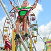 Bo Bundy, 5, son of Dwight and Reagan Bundy, of Lewisburg bungy jumps at the West Virginia State Fair in Fairlea.<br /> (Rick Barbero/The Register-Herald)