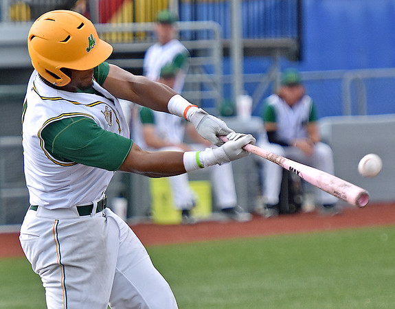 (Brad Davis/The Register-Herald) West Virginia's Tre Porter gets a hit during the Miners' extra innings win over Champion City Sunday evening at Linda K. Epling Stadium.