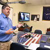 (Brad Davis/The Register-Herald) Mike Jude, training instructor at the National Mine Health and Safety Academy, shows off a mock command center that would be used in the case of a disaster during a tour of the facility on its 40th anniversary celebration Wednesday afternoon off Airport Road.