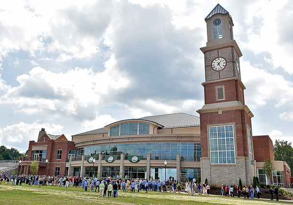 (Brad Davis/The Register-Herald) An army of state and local leaders, community members and school administrators gather at the brand new Student Center on the campus of the West Virginia School of Osteopathic Medicine prior to a ribon cutting and open house event Friday afternoon in Lewisburg.
