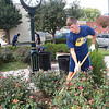 Corbin Oliver, freshman WV Tech Montgomery campus, helps cleanup the Midland Trail Park off of Main Street in White Sulphur Springs.<br /> (Rick Barbero/The Register-Herlad)