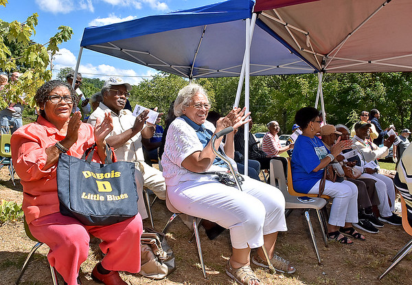 (Brad Davis/The Register-Herald) A mix of alumni and family members take in the celebration during a ribbon cutting and unveiling ceremony for the DuBois High School museum's giant mural Saturday afternoon in Mt. Hope. At far left is Dean Clark and beside her is Erma Wallace, among many others.
