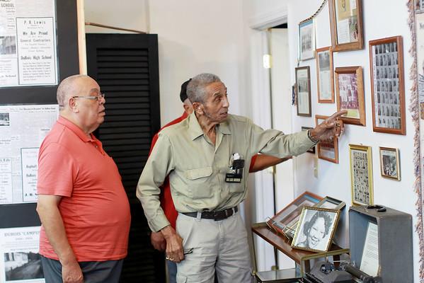 """Howard """"Red"""" Scott, left, Jordan Evans, look over old photos of themselves from attending Dubois High School in Mt. Hope. (Chris Jackson/The Register-Herald)"""