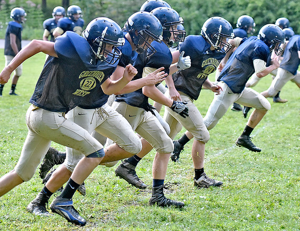 (Brad Davis/The Register-Herald) Cavaliers football players run sprints near the end of a practice Friday afternoon at Greenbrier West High School in Charmco.