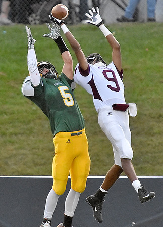 (Brad Davis/The Register-Herald) Woodrow Wilson defensive back Kelshawn Grant breaks up a deep pass attempt to Greenbrier East's William Honaker Friday night in Fairlea.