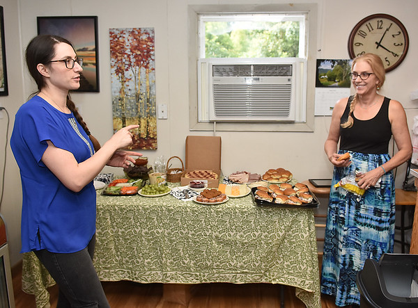 (Brad Davis/The Register-Herald) Owner Sierra Hattier, left, and her mother Julie prepare for opening festivities at the Lansing General Store, located at 349 Lansing-Edmond Road in Lansing September 3.