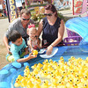 Justin and Avery Vonderheid with their two children, Braylen, 7, and Meadow, 15 months at the Luck Duck they own at the West Virginia State Fair in Fairlea.<br /> (Rick Barbero/The Register-Herald)